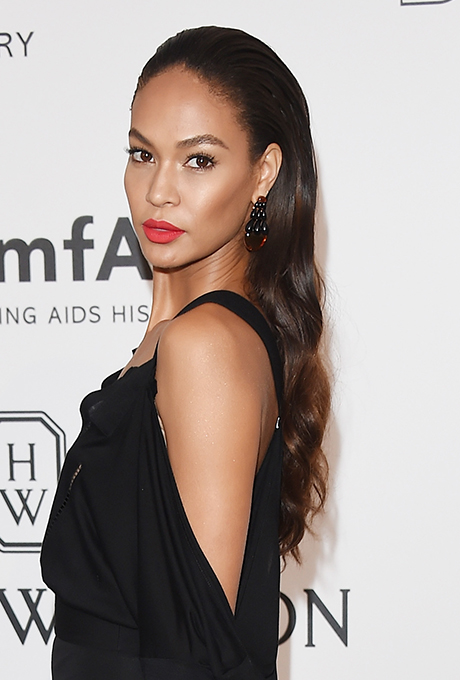 Joan Smalls' Slicked-Back Waves  An easy way to get romantic waves but ensure the locks don't fall in your face? Make like Joan and slick the front back with styling spray.