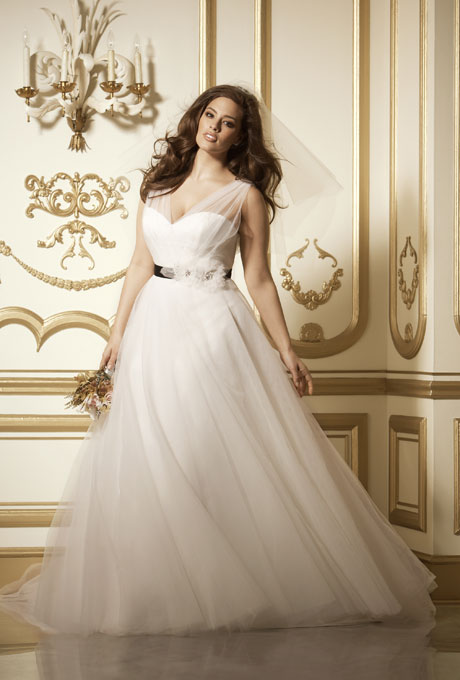 "Photo: Courtesy of Wtoo    Style 11713, ""Phoenix"" ivory tulle v-neck, v-back with full skirt, $1,600,  Wtoo     See more Wtoo wedding dresses."