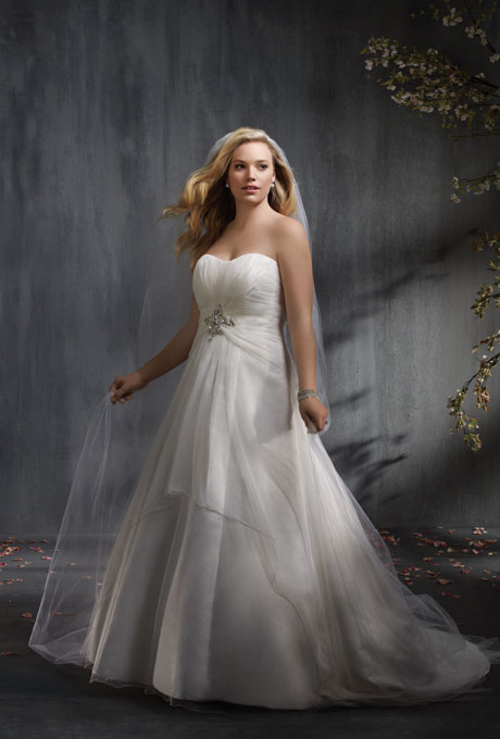 Photo: Courtesy of Alfred Angelo    Style 2335, soft net over satin wedding dress with rhinestones, crystal beading, pearls, sequins, and metallic accents, $849,  Alfred Angelo     See more Alfred Angelo wedding dresses.