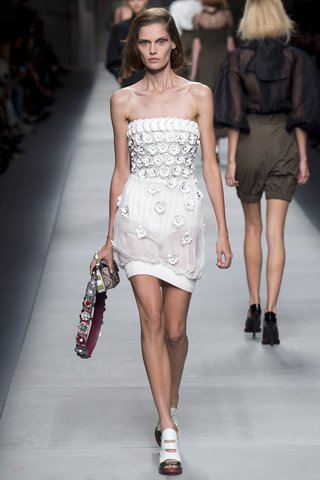 Fendi   For the sports fanatic bride, a strapless minidress with athletic influences gets a dose of girliness with floral embellishments.  Photo: Indigitalimages.com