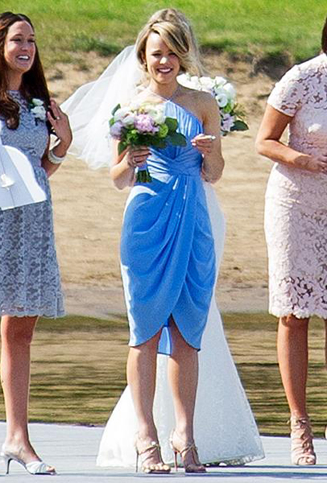 Rachel McAdams knows a thing or two about weddings, thanks to her many roles in the best romantic comedies of our age. She recently put her experience to good use as  her sister Kayleen's maid of honor ! McAdams was seen wiping away tears at her younger sister's Canadian nuptials. She looked good doing it, too — she donned a draped, halter bridesmaid dress in a gorgeous light blue color.  Photo via Twitter