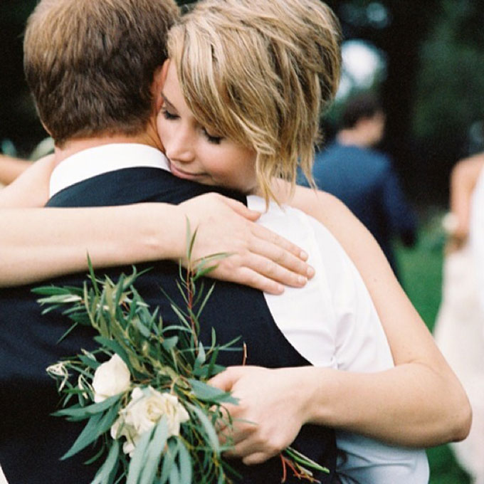 J. Law is one of the biggest movie stars on the planet, but on her brother Blaine's wedding day last year, she was just another bridesmaid in yellow. Her J.Crew dress wasn't quite the Dior couture we're used to seeing her in, but this heartwarming moment with her brother is the typical every girl reaction we've come to expect from her.  Photo: Ryan Ray via  Instagram
