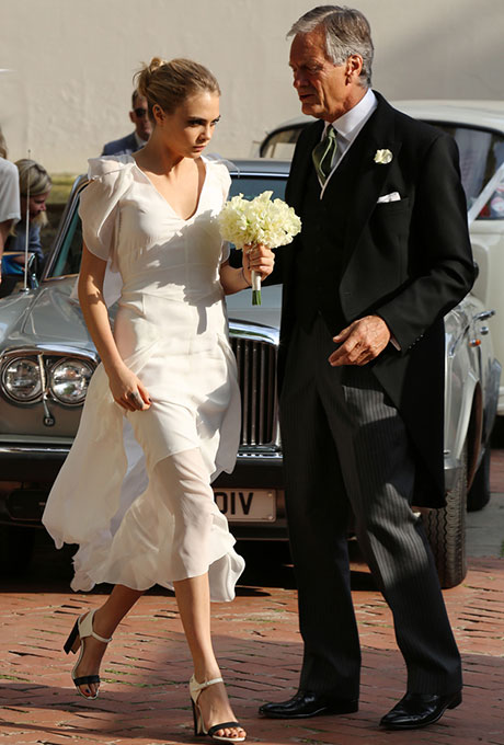 The supermodel pulled a Pippa Middleton while  serving as her big sister Poppy's maid of honor last May , donning a floor-length white Chanel gown with a flutter detail on the neckline and sleeves. We love how she kept the rest of the look understated, with a simple bun and killer shoes.  Photo: Getty Images