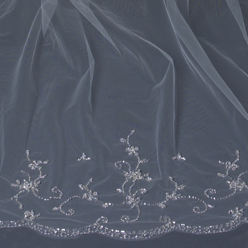 "Beautiful single layer cathedral length bridal veil with hand sewn embroidery throughout the veil accented with faceted crystal like petals, sequins and clear and silver bugle beads throughout. This wedding veil is absolutely breathtaking.  Length: 108"" inch long x 71"" inch wide"