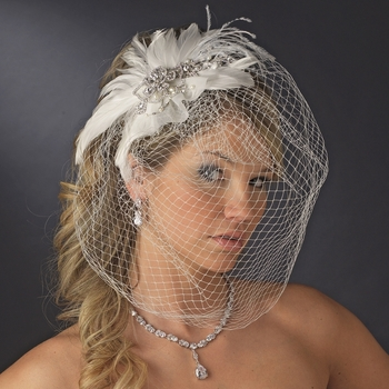 Russian Bridal Face Net & Blusher Birdcage Veils are an elegant and high fashion accessory for your modern couture or old 20's vintage touch wedding celebration. Unique and exquisite this selection of birdcage blushers vary in length, design, color, and some include an elegant feather fascinator accent addition.