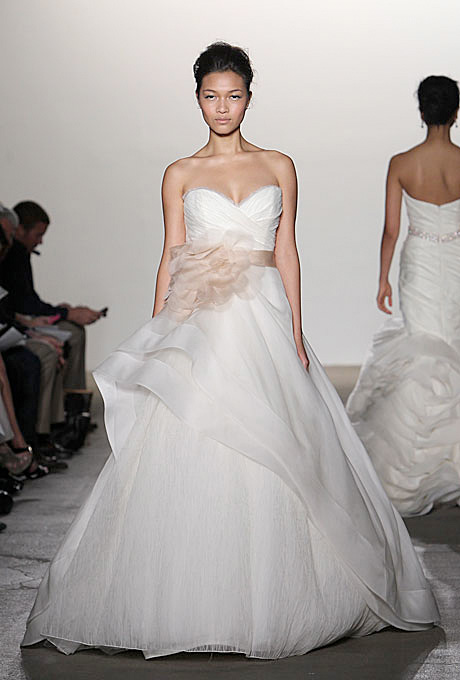 Rivini   Gown by  Rivini     Browse more Rivini wedding dresses.   Photo: Steve Eichner