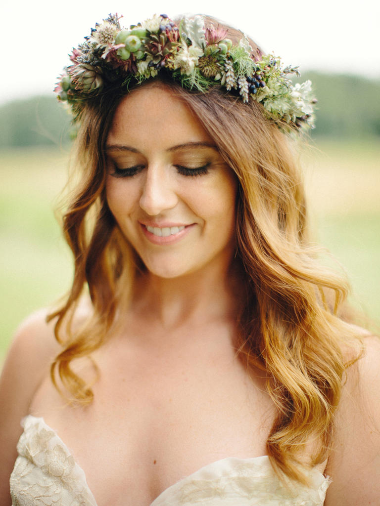 PHOTO BY NICOLE HALEY PHOTOGRAPHY  To match her crown of greenery and loose waves, this bride went with a wash of shimmery green-gold eye shadow. Finishing with nude lipstick complements her au naturel vibe.  From the album  A Laid-Back, Bohemian Wedding at Misty Farm in Ann Arbor, Michigan