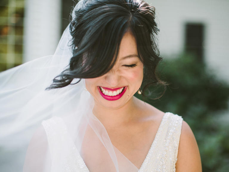 PHOTO BY JILL DEVRIES PHOTOGRAPHY  Use your makeup to play up your favorite facial feature, like this bride did. A hot pink lipstick puts all eyes on her pout.  From the album  A Chic Fall Wedding at Windmill Island in Holland, Michigan