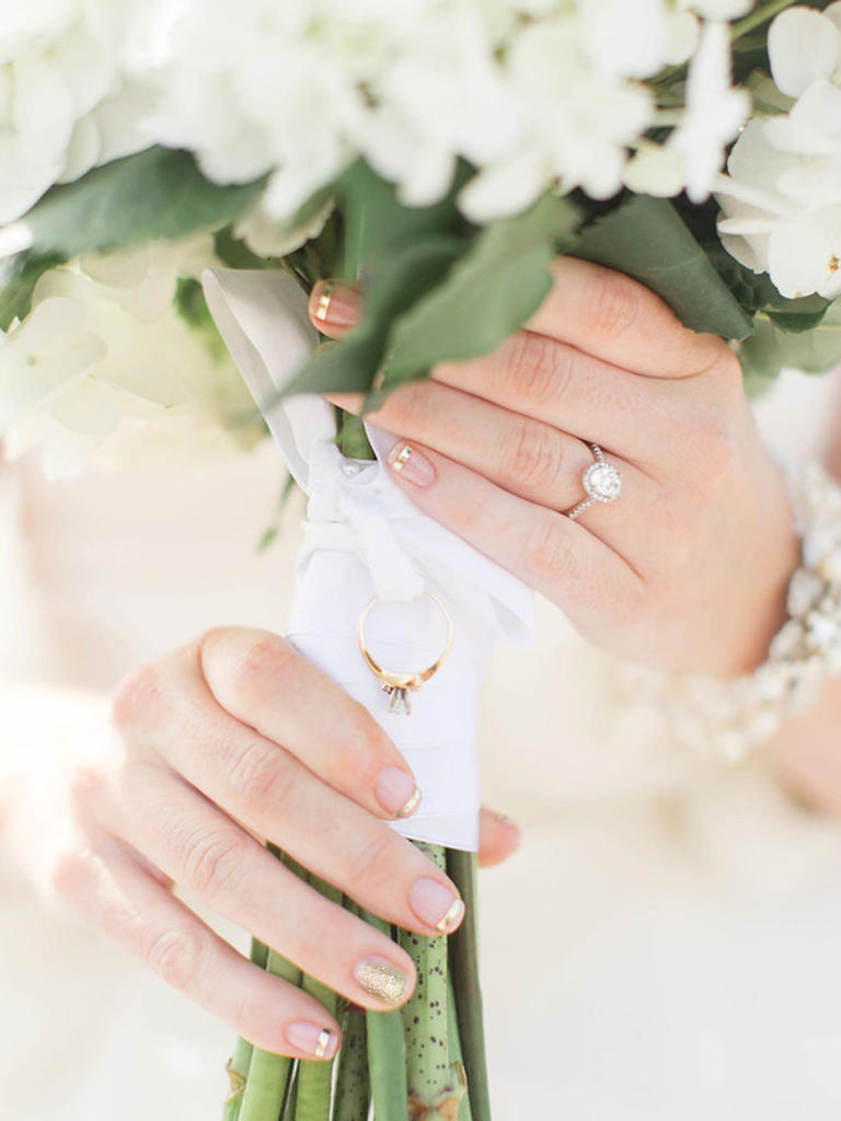 PHOTO BY JILLIAN MICHELLE PHOTOGRAPHY  For a subtle and unexpected take on the traditional French manicure, offset gold stripes with one glittery nail. It's a look guaranteed to draw eyes to your fingers—and, of course, your ring.  From the album  A Bright, Bayside Wedding at the Lesner Inn in Virginia Beach, Virginia