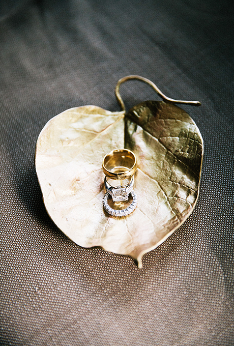 Wedding rings sitting in a gilded jewelry dish.  Photo: Lauria & Gennia of  Docuvitae
