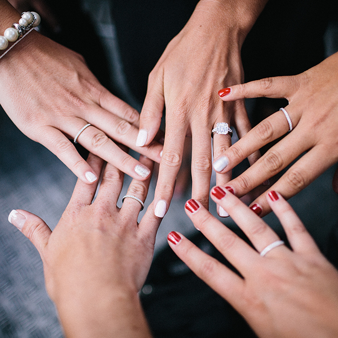 Get the girls together for a wedding ring pic with your already-married bridesmaids!  Photo: Lauria & Gennia of  Docuvitae