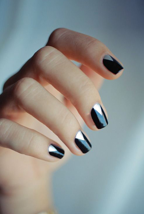 A black-and-silver manicure.  Photo: Hannah Baker via  Pinterest