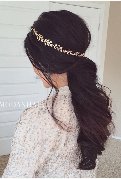 Channel your inner goddess by dressing up your swept-back ponytail with a gold tiara.  Photo:  Ulyana Aster