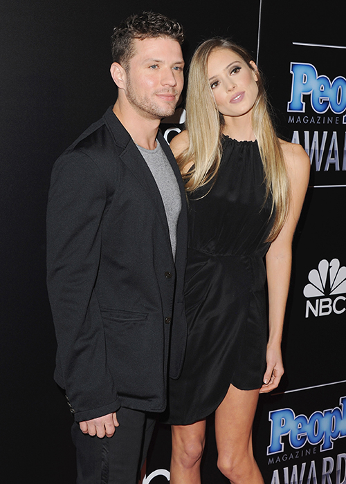 """That's one way to ring in the New Year! Ryan Phillippe  is engaged  to his longtime love, Paulina Slagter, having popped the question over the Christmas holiday. (Looks like celebrities partake in  engagement season , too!) And it sounds like these two have already been marking their calendars with their epic plans to ring in 2016 together — which we hope includes lots of  wedding planning .  The newly engaged couple has already stepped out for their first official appearance as fiancé and fiancé. Slagter, a 24-year-old law student, was recently seen showing off her new  engagement sparkler  at Seaspice in Miami while dining with her new groom-to-be,   People   reports. Phillippe, 41, reportedly popped the question to his girlfriend of four years with a bended knee moment over the Christmas period. And these two lovebirds wasted no time in making New Year's party plans by planning to celebrate their new status at the Five Star New Year's Eve event on Watson Island in Miami, headlined by deejay Robin Shulz, according to  People .   See More:  Our Favorite Celebrity Engagement Rings    The  Crash  actor will be kicking off 2016 by expanding his budding family, which includes 16-year old daughter, Ava, and 12-year old son, Deacon, from his first marriage to his ex-wife, and Academy Award-winning actress,  Reese Witherspoon . Phillippe is also dad to 4-year old daughter, Kai, from a previous relationship with former girlfriend, and  Pitch Perfect  star, Alexis Knapp.  The actor opened up about Slagter on Howard Stern's SiriusXM radio show back in April, proclaiming that he was """"not opposed"""" to walking down the aisle again. Phillippe continued to gush about his then-girlfriend, """"She's awesome. When people see her they have these judgments because she could be a model but she's about to graduate Stanford Law."""" Phillippe couldn't help but brag about his longtime love by adding, """"Also what's great about it — as you get older certain issues become more important to you. I'm """