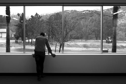 7e42faf50 Photographer Adam Queen watches the rain at the SB Fulfillment Center Photo  Studio for HauteLook