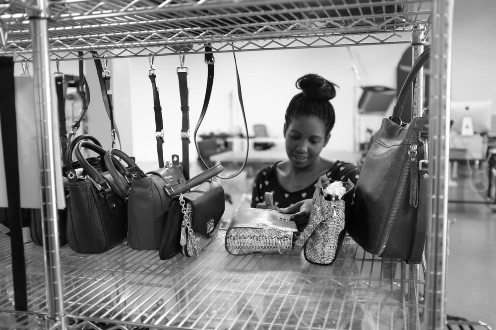 Product Stylist Loretta preps handbags at the HauteLook SB Photo Studio