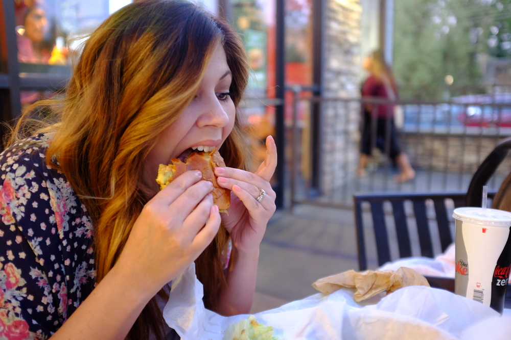 Alesia enjoys her burger from Bucket List Burgers in Canyon Crest