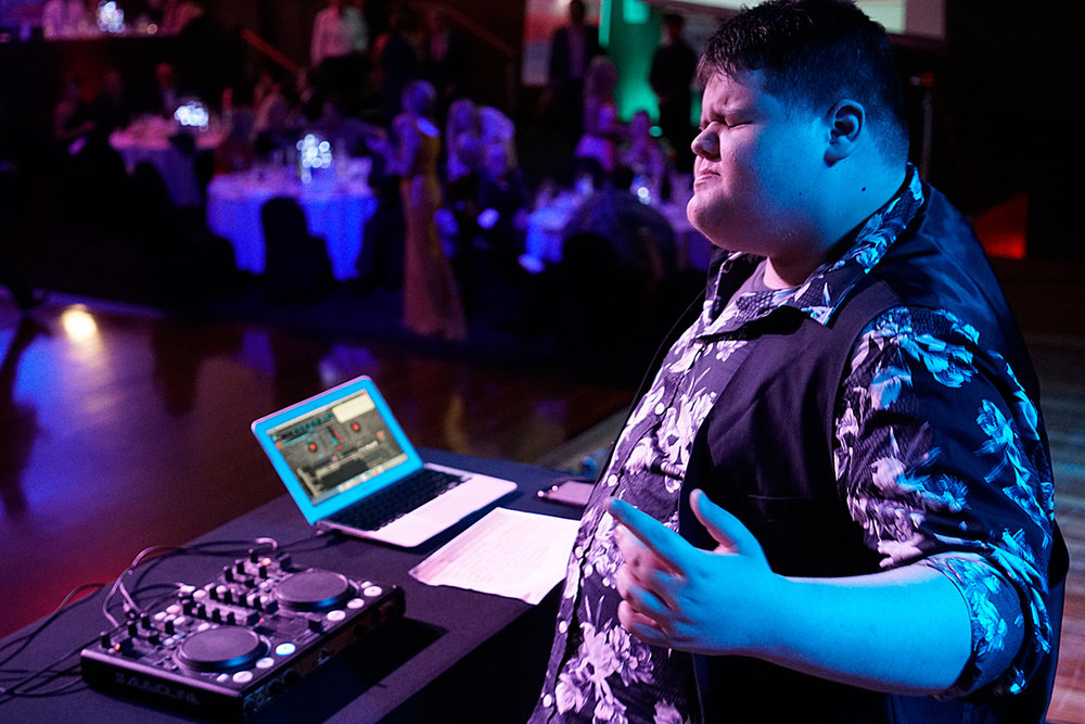 Jackson playing a DJ gig for a school fundraiser. Photo credit: David Drews