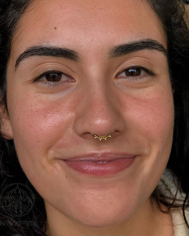"Fresh septum piercing on this lovely client! Beautiful yellow gold ""Sabrina"" from the wonderful folks at @anatometalinc. Piercing by @piercedbytony. . . . . . #braindropslovesyou #anatometal #anatometalinc #anatometalinc #braindropstattoo #septumpiercing #piercing #septum#sanfrancisco #haightstreet #california"