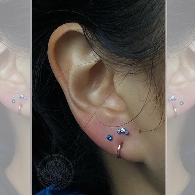 Have existing piercings with unusual placement? Let us help you transform them into a composition you'll love. This client came in wanting two additional lobe piercings above her existing holes that have a slightly lower placement. Instead of trying to place them lined up with the lower holes, we curated a beautiful look incorporating it. . . . . Two upper lobe piercings by @piercedbytony. Jewelry from @anatometalinc and @intrinsicbody. #braindrops #braindropssf #braindropslovesyou #sanfrancisco #sf #haightstreet #haighyashbury #curatedear #eargoals #piercing #piercinggoals #earpiercings #braindropstattoo #braindropspiercing #anatometal