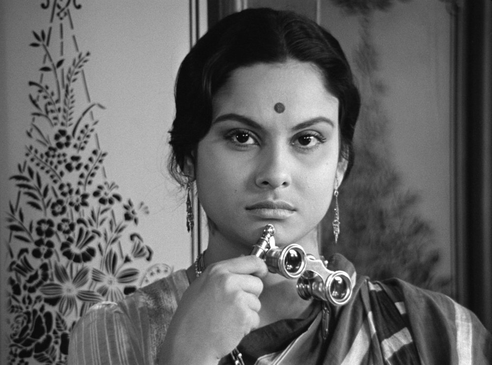 charulata-1964-003-woman-holding-opera-glasses.jpg