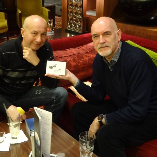 Neuronium     Michel Huygen (Neuronium, right side) receives his midiBeam from Gabor (pandaMidi, left side) at the lobby of Marriott, Budapest.