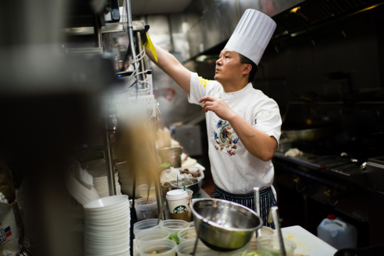 Chef Kevin Li cooks at Reren Lamen & Bar in Chinatown in 2016. (Sarah L. Voisin/The Washington Post)
