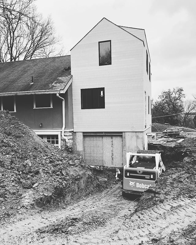 Winter's here and work continues. . Phase II of excavation underway for concrete retaining wall and new concrete driveway. It's working with people who are good at what they do and enjoy the work that make the cold days worth it. . . . #studiowilde #sjw #construction #kansascity #westwoodhills #addition #residential #residentialdesign #residentialconstruction #construction #architecture #excavation #framing #carpentry #building