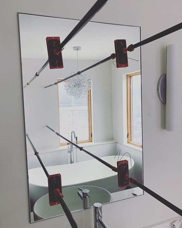 How do you apply pressure to a mirror while the mirror mastic sets you ask?! We made good use of our #zipwall extension poles! They were perfect for the job, applying the right amount of pressure but not scuffing up any painted walls. . Used a @stylmarkinc anodized aluminum profile to frame the mirrors. Miters were cut in the field and installed so the glass would fit snuggly inside the frame that was mounted to the wall ahead of adhering the mirror to the drywall. . It's the fine detail work that is most rewarding when it all comes together. . . . #studiowilde #mirror #carpentry #residential #residentialdesign #residentialarchitecture #interiordesign #simple #construction #residentialconstruction #finecarpentry #designbuild #kcmo #kansascity #missouri
