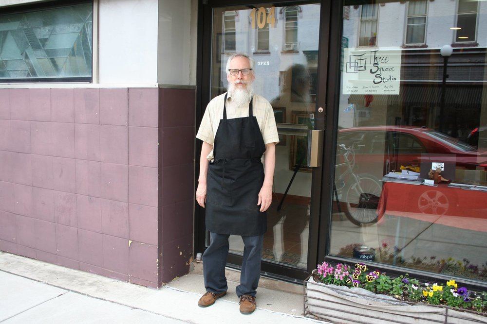 Brian standing outside of his gallery in downtown Bloomington. Photo by Menendez 2016.