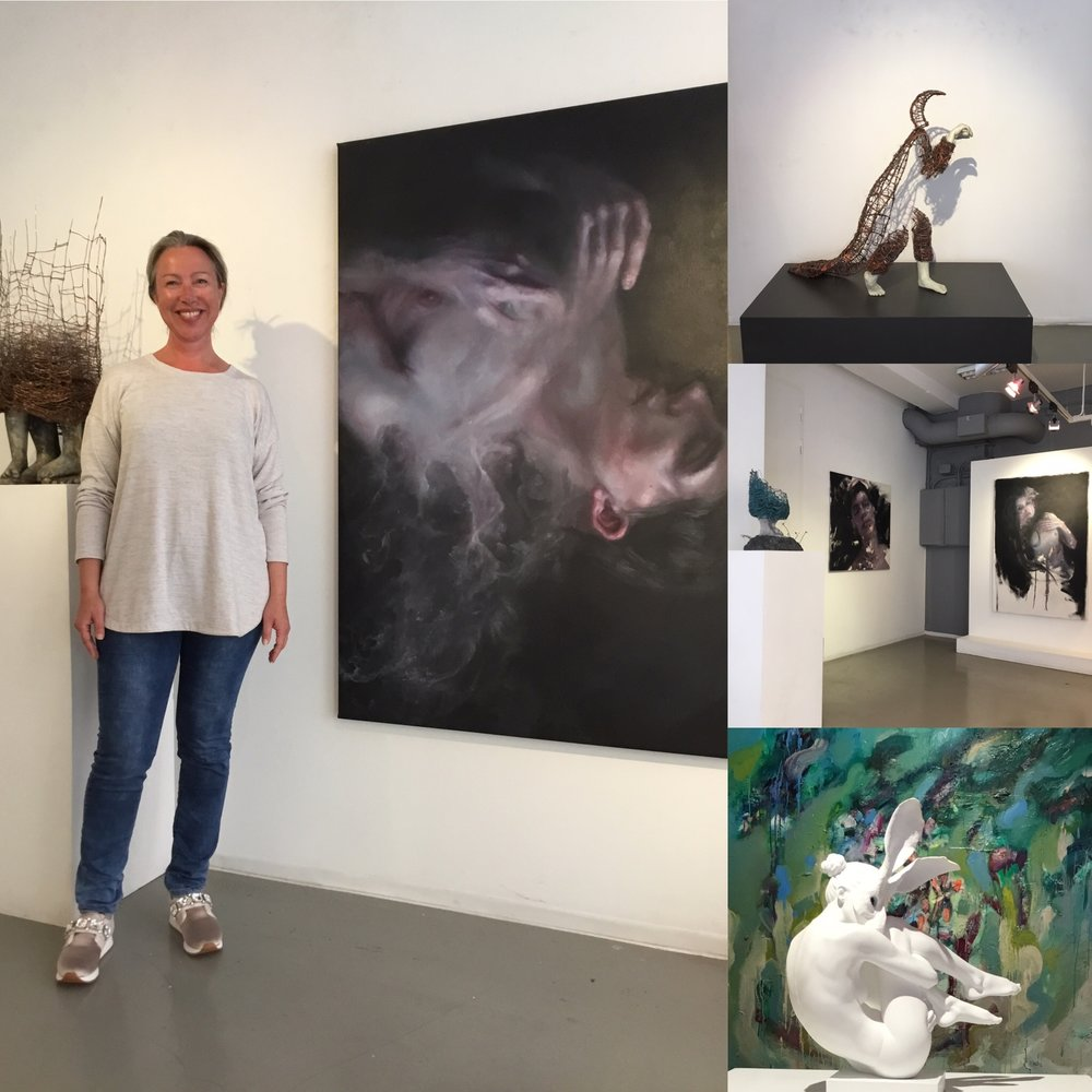 Elisabeth Ramfjord, here with paintings of Henrik Aa. Uldalen og sculptures of Lene Kilde.