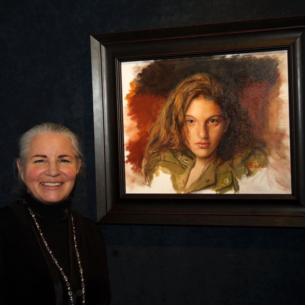 Robin Damore next to her painting.