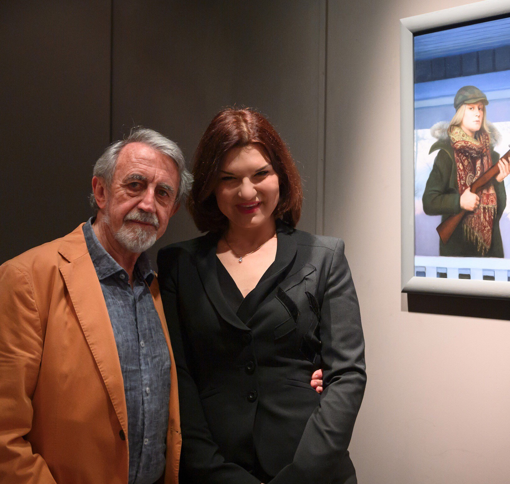 MEAM Director José Manuel Infiesta and Natalie Holland next to her painting  Mamma's House