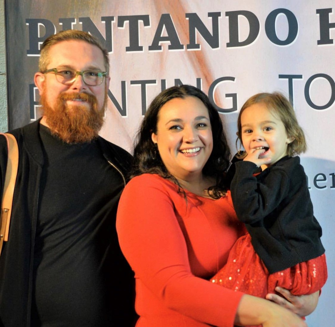 Sara Scribner on the red carpet with husband artist Shane Scribner and their daughter