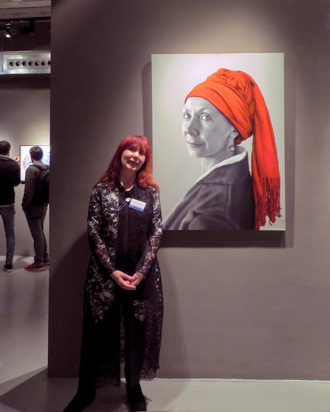 Arina Gordienko next to her painting  The Smile