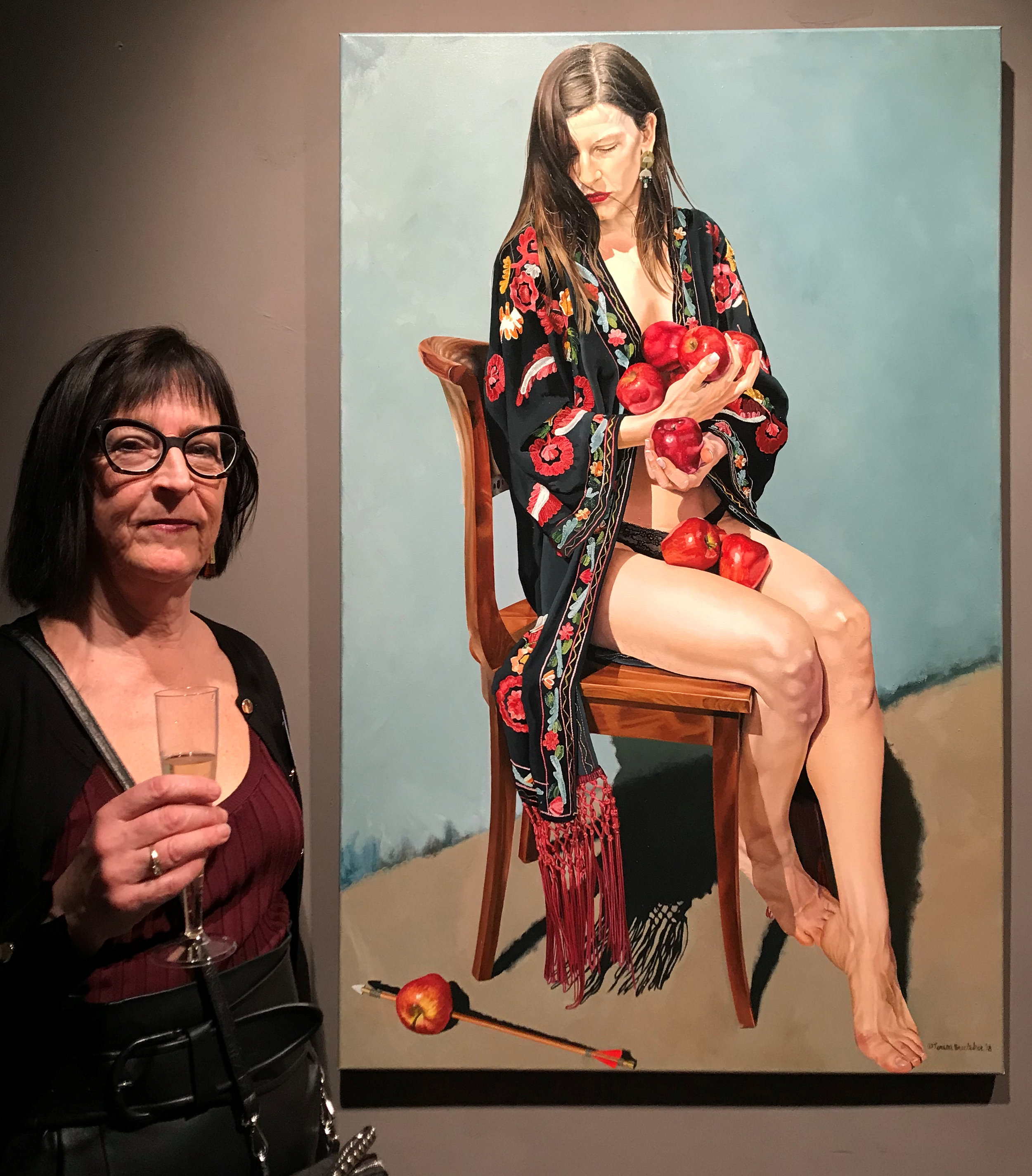 Teresa Brutcher next to her painting entitled  William won't tell