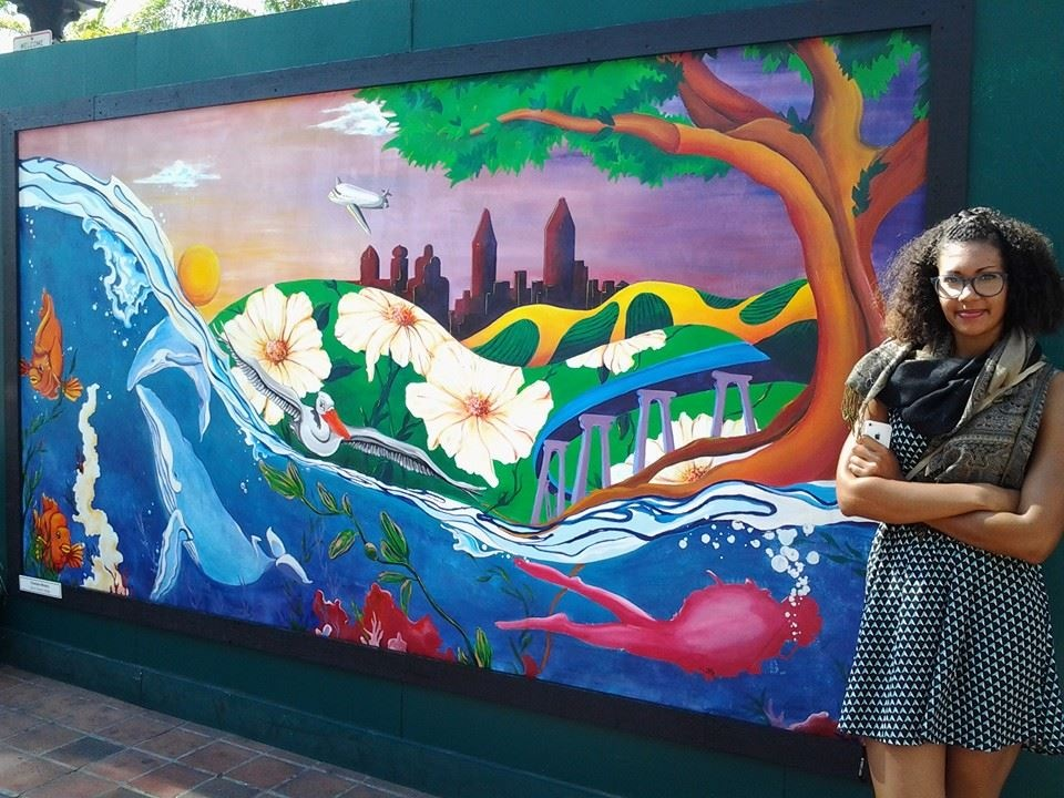 Charlene Mosley  with mural   Horton Plaza Barricades, Downtown San Diego