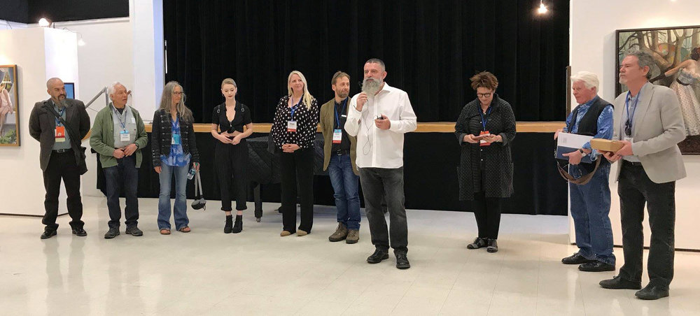 The attending Illusionists, from left to right: Guy Kinnear, Boris Vallejo, Julie Bell, Kenna Houtz, Pamela Wilson, Conor Walton, Michael Pearce (curator), Regina Jacobson, Roger Dean, and F. Scott Hess – Photo credit Lori A. Escalera.