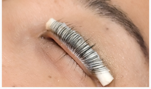 Lash lift - This beauty treatment has become very popular in the past couple years. A lash lift uses a perming solution to boost and lift your natural lashes, making them look longer and curled. This treatment takes a little bit over an hour and your eyes will be closed 90% of the time. Lashes are combed and adhered onto a guard that will keep them in their perfectly curled stance. Then, a series of perming, setting, & nourishing solutions are applied to the lashes to keep them in their perfectly lifted state. See results right away! Lashes cannot get wet 48 hours post treatment. This for some, is a better alternative to lash extensions because it is less maintenance and more natural looking.