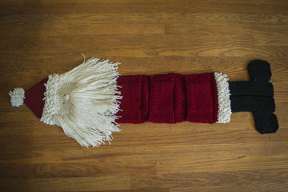 Ho Ho Ho!  A hand-knit Santa Claus to help you treasure your cards of cheer the whole season!