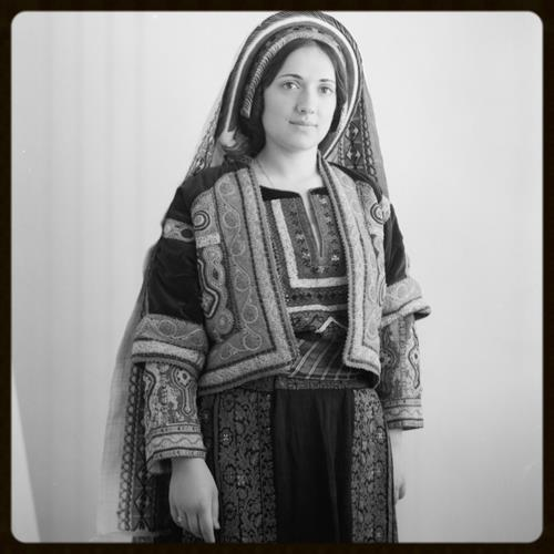 Wedad Khuri in finely embroidered Ramallah costume, 1939
