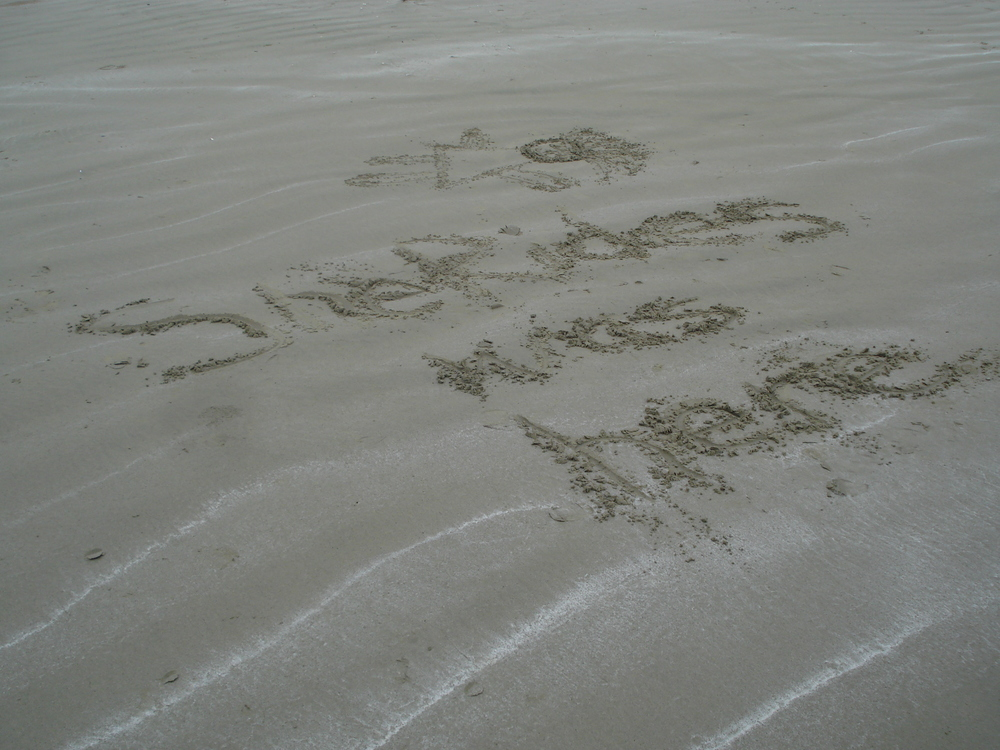 SheRides was here - written in the sand at Ucluelet BC