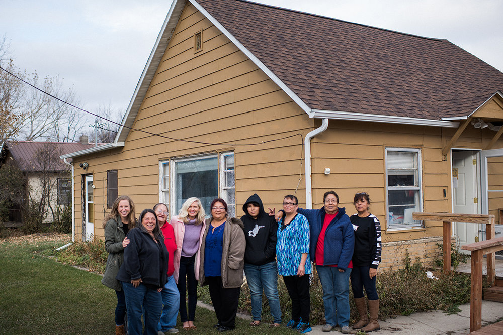 "Co-founder Emily outside of ""Her House"" with the women of the Rosebud Reservation"