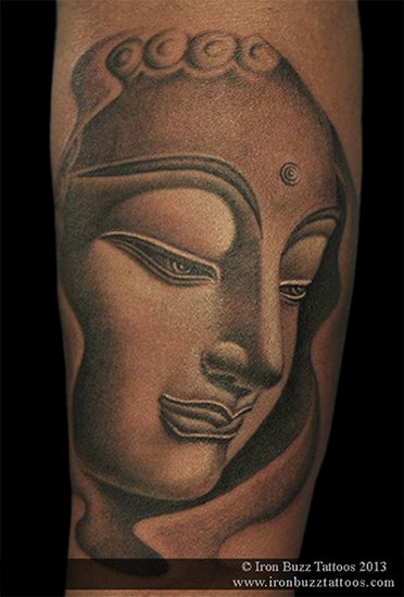 Buddha tattoo on forearm