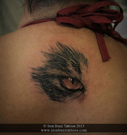 cat_eye_on_back_nape_tattoo_best_design_for_men_and_women_by_artist_eric_dsouza_at_iron_buzz_tattoos_and_piercing_versova_andheri_mumbai.jpg