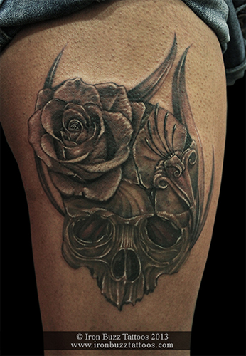 Custom_Skull_with_rose_on_thigh_black_and_grey_tattoo_best_design_for_men_and_women_by_artist_eric_dsouza_at_iron_buzz_tattoos_and_piercing_versova_andheri_mumbai.jpg