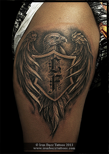 Eagle_with_initials_on_shield_family_theme_on_arm_black_and_grey_tattoo_best_design_for_men_and_women_by_artist_eric_dsouza_at_iron_buzz_tattoos_and_piercing_versova_andheri_mumbai.jpg