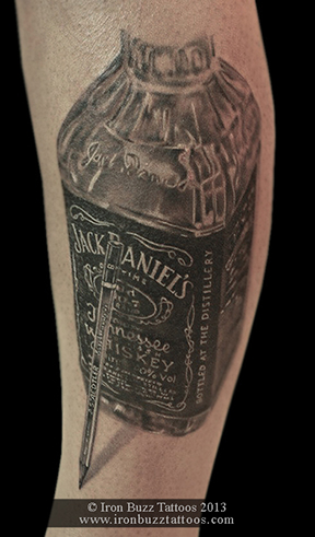 Jack_Daniels_Whisky_on_ankle_black_and_grey_tattoo_best_design_for_men_and_women_by_artist_eric_dsouza_at_iron_buzz_tattoos_and_piercing_versova_andheri_mumbai.jpg