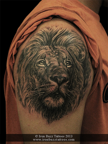 Lion_portrait_on_arm_black_and_grey_tattoo_best_design_for_men_and_women_by_artist_eric_dsouza_at_iron_buzz_tattoos_and_piercing_versova_andheri_mumbai.jpg
