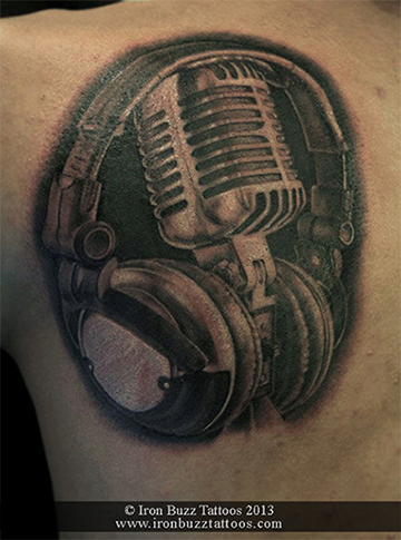 Music_theme_head_phones_with_mike_on_shoulder_back_black_and_grey_tattoo_best_design_for_men_and_women_by_artist_eric_dsouza_at_iron_buzz_tattoos_and_piercing_versova_andheri_mumbai.jpg